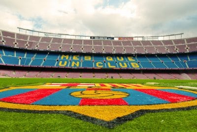 Camp nou pitch with fc barcelona logo