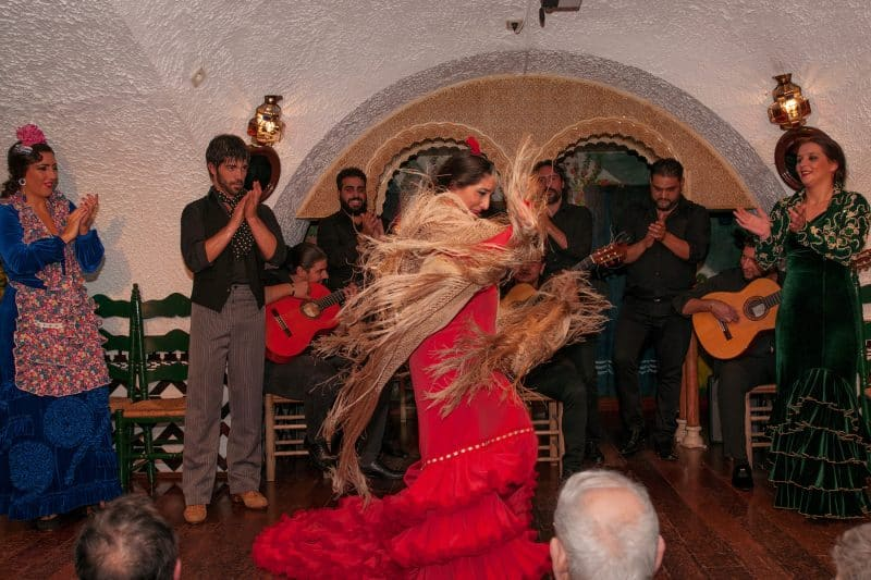 flamenco dancer with musicians
