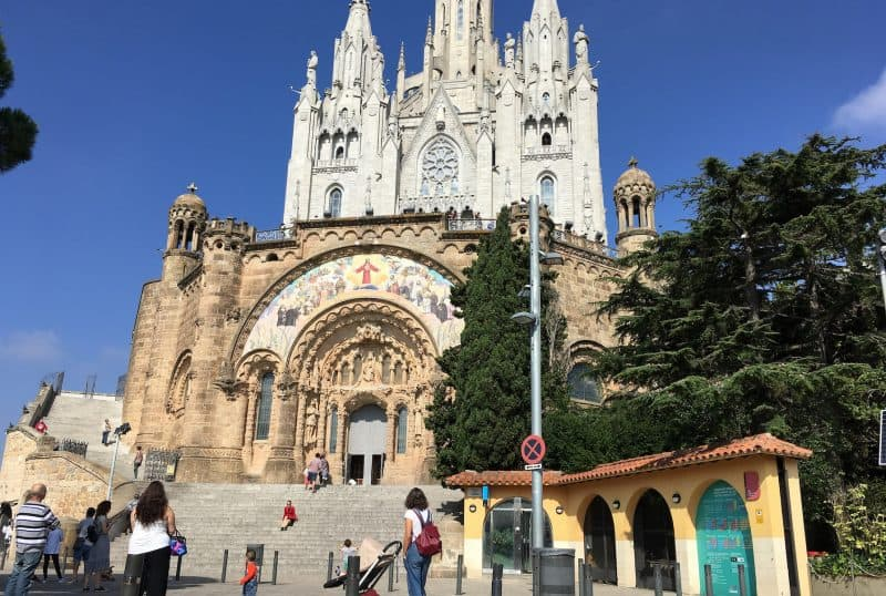 Beautiful church at the Tibidabo with people in front of it